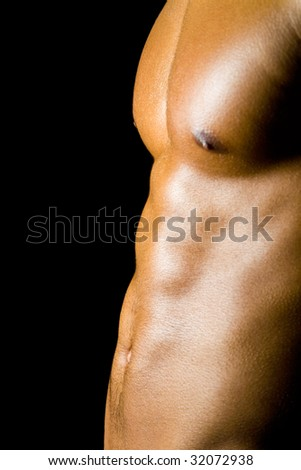Abdominal muscles of a young male - stock photo