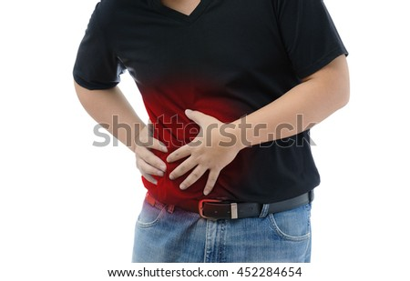 Abdominal Pain. Man suffering from stomach ache. He holds his stomach and has hurt. on white background - stock photo