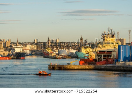 Aberdeen, Scotland, UK, August 30th 2017. Aberdeen harbour basin, ships, piers, city centre and small lifeboat.