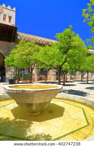 Ablution fountain in the patio of the Cathedral of Saint Mary of the See (Seville Cathedral) in Seville, Andalusia, Spain - stock photo