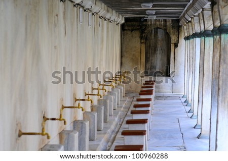 Ablution taps at a mosque in Istanbul where worshippers wash their feet, Istanbul, Turkey - stock photo