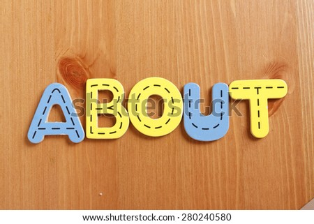 ABOUT, spell by woody puzzle letters with woody background - stock photo