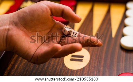 About to throw the dices - stock photo