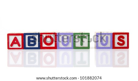 About us in alphabet word blocks isolated on a white background with reflection. - stock photo