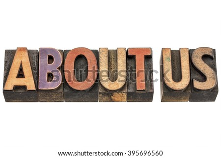 about us - isolated words in vintage letterpress wood type stained by color inks - stock photo