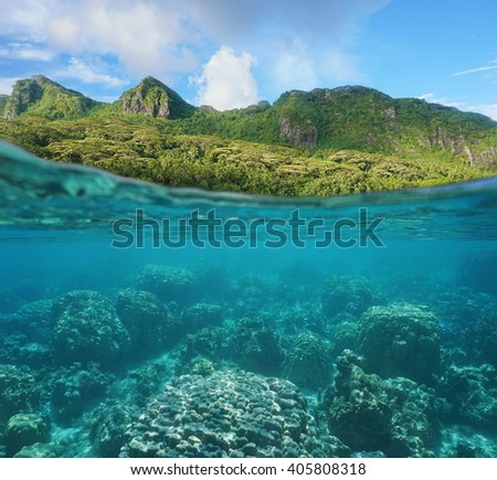 Above and below water surface with lush coast and coral reef underwater split by waterline, Huahine island, Maroe bay, Pacific ocean, French Polynesia - stock photo