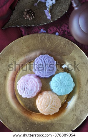 Above of snow skin mooncake on golden plate - stock photo