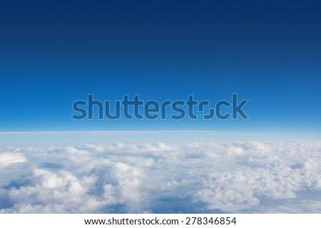 Above The Clouds Photo of puffy clouds - stock photo