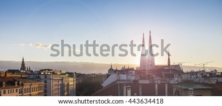 Above the roofs of Vienna - with the Votive church at sunset - stock photo