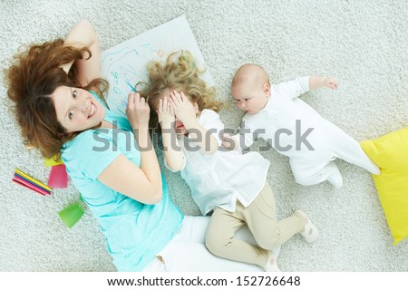 Above-view image of a playful family enjoying spending time together - stock photo