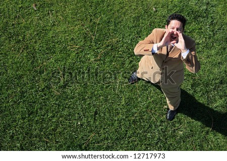 Above view of a business man speaking to the sky - stock photo