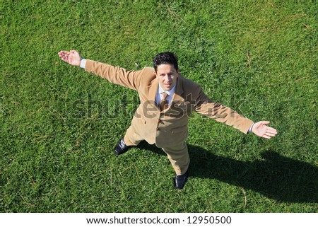Above view of a business man with his arm outstretched looking to sky