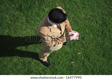 Above view of a business man writing something