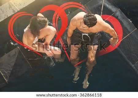 Above view of a couple talking against heart - stock photo