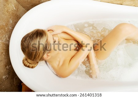 Above view of a woman relaxing in bath. - stock photo