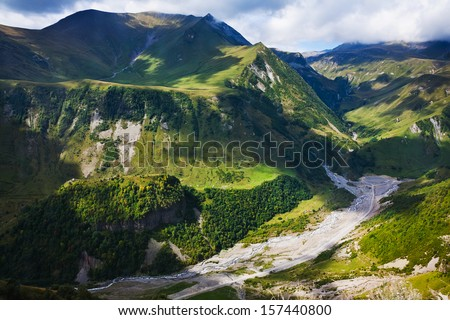 above view of Aragvi river valley near Cross Pass in Caucasus mountains in Georgia