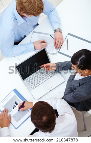 Above view of business partners working at meeting - stock photo
