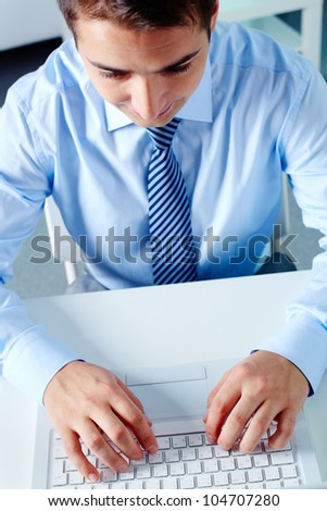 Above view of businessman working with laptop at workplace - stock photo