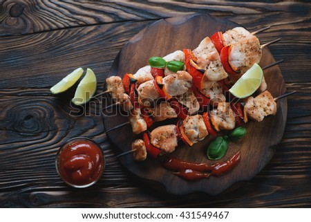 Above view of chicken kebabs in a rustic wooden setting