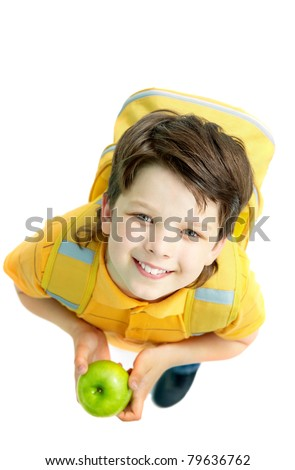 Above view of handsome boy with a green apple isolated on a white background - stock photo