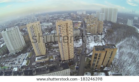 Above view of high residential buildings in neighborhood at winter. Aerial view
