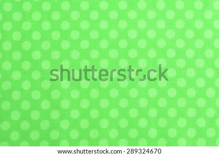 Above View of Polka Dot Woven, Cotton Fabric for a Colorful, Monochromatic Two-tone medium green Background Template, use horizontal or vertical with room or space for text, copy, words. Photo - stock photo
