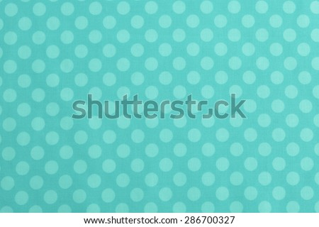 Above View of Polka Dot Woven, Cotton Fabric for a dull Colorful, Monochromatic Cyan, Teal or Turquoise Background Template, use horizontal or vertical with room or space for text, copy, words. Photo