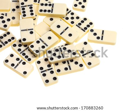 above view of scattered dominoes isolated on white background