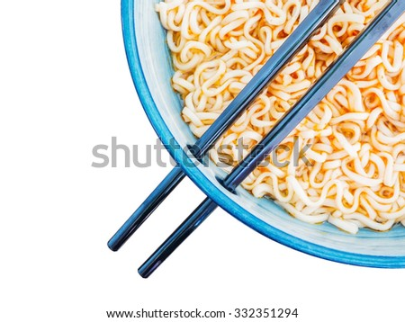 Above view of spicy instant noodles in blue  bowl with chopsticks isolated on white background - stock photo