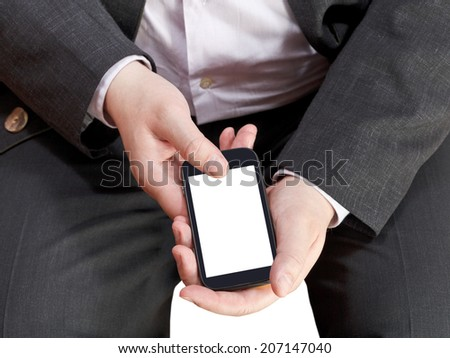 above view of touchscreen mobile phone with cut out screen in businessman hand isolated on white background - stock photo