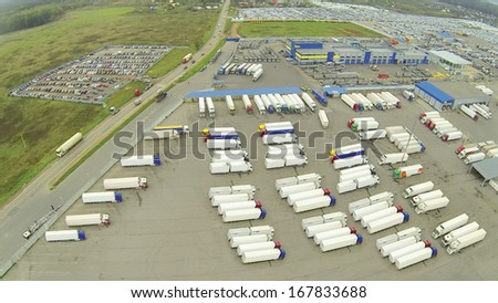 Above view of truck parking. View from unmanned quadrocopter. - stock photo