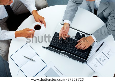 Above view of two business people communicating at work