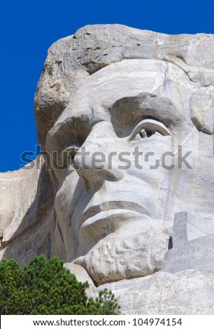 Abraham Lincoln face on Mount Rushmore National Memorial - stock photo