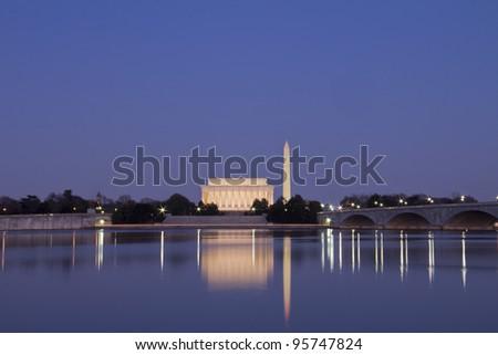 Abraham Lincoln Monument, Arlington Memorial Bridge and Washington Monument with reflection on Potomac River at sunset, Washington, DC, United States - stock photo