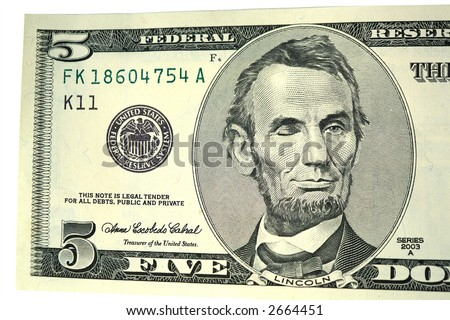 Abraham Lincoln on five dollar bill winking - stock photo