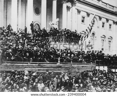 Abraham Lincoln's delivering his second inaugural address (standing, center) on the east portico of the U.S. Capitol, March 4, 1865, his second inauguration. - stock photo