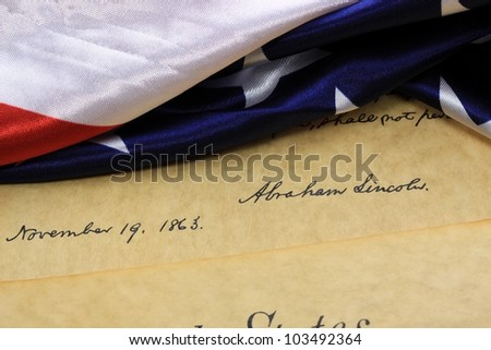 Abraham Lincoln - Signed and Dated Constitution of the United States and American Flag - stock photo