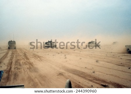 Abrams tanks of the 1st Armored Division 7th Corps move across the desert in northern Kuwait during Operation Desert Storm. Feb. 28 1991. - stock photo