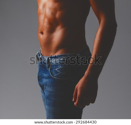 abs of a man close up studio photo shooting with shadows - stock photo