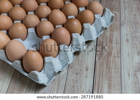 Absent concept : An egg disappears from the group of eggs. Picture illustrates absent concept in business world. - stock photo