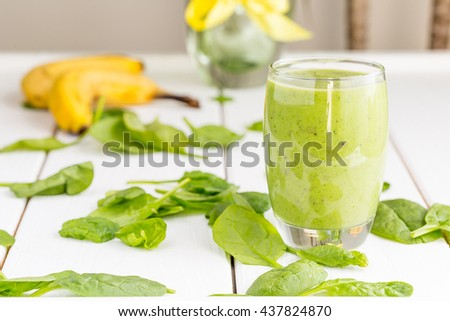 Absolutely Amazing Tasty Green Avocado Shake or Smoothie, Made with Fresh Avocados, Banana, Lemon Juice and Non Dairy Almond Milk on White Wooden Background, Raw, Vegan Drink, Vegan Food Conception - stock photo