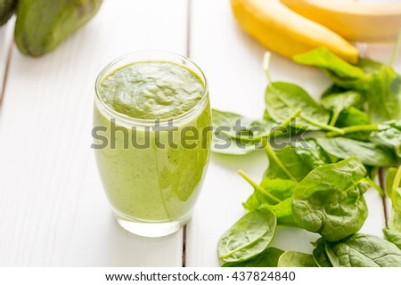 Absolutely Amazing Tasty Green Avocado Smoothie, Made with Fresh Avocados, Lemon Juice and Non Dairy Milk (Almond, Coconut) on Light White Wooden Background, Raw Vegan Drink, Vegan Food Conception - stock photo