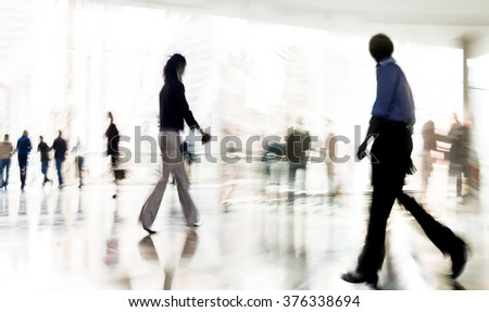 absta?t image of people in the lobby of a modern business center with a blurred background