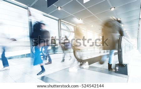 abstakt image of people using a skywalk/staircase