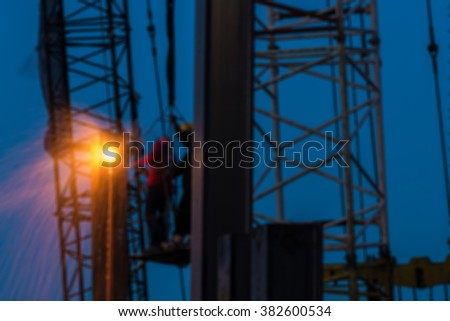 Abstract and Blur Welding steel workers - stock photo