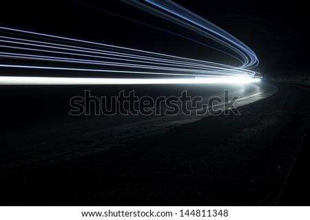 Abstract and interesting art concentration of blue light in a road tunnel - stock photo