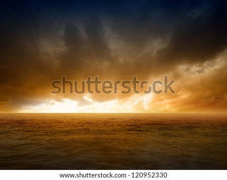 Abstract apocalyptic background - dramatic red sunset over sea, end of world - stock photo