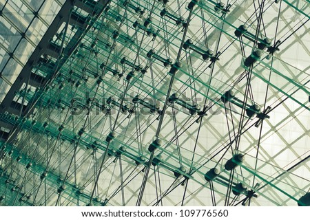 Abstract architectural wall of glass and steel in business center - stock photo