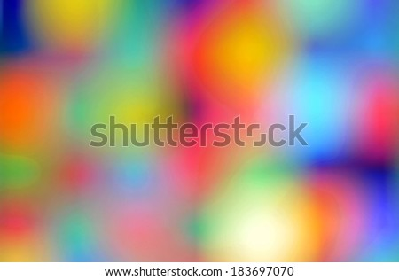 Abstract arrangement of a vibrant and multicolored wallpaper with blurry shining spots of light.  - stock photo