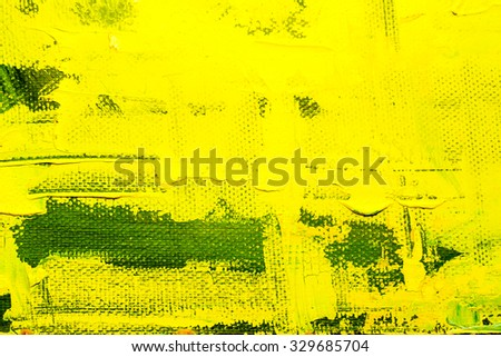 Abstract art  background. Oil painting on canvas. Yellow and green texture. Fragment of artwork. Spots of oil paint. Brushstrokes of paint. Modern art. Contemporary art.